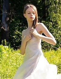 Gorgeous Slim Girl Posing Absolutely Naked Outdoor In The Field On The Plastic Sheeting.