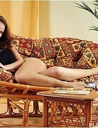 Daniela exposing pantyhose on couch