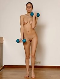 Dumbbells and rocker for a naked fit girl