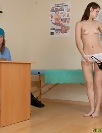Undressed gal gets measured at a physical exam