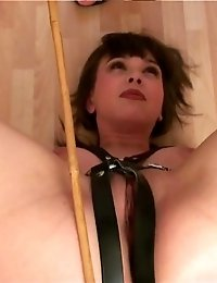Bubbied sports babe exercising in a femdom harness