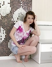 Gorgeous Think Small Breasted Nude Model Posing For Camera Beside Black And White Wall Mosaic. Never