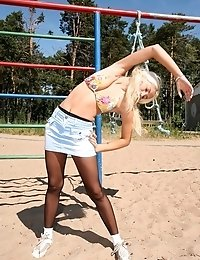 Blonde Anastasia in pantyhose doing exercises outdoors