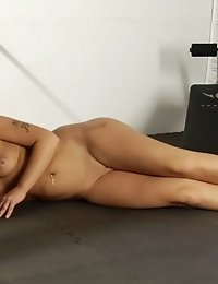 Nude submissive trainee of an uncompromising male coach
