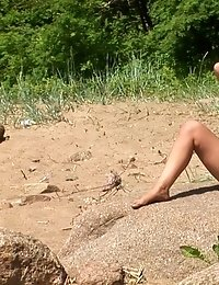 Horny blond engaged in beach nude sports