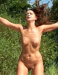 Stretching and jumping nude beach gymnast