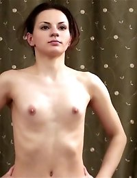Home gymnastics and yoga by a nude brune