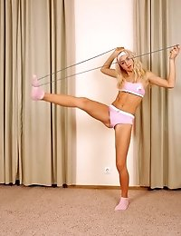 Sexy sporty kitten with a skipping-rope