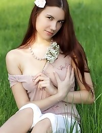 Charming Teen Peach With A Bow In Her Hair Undressing And Showing Luxurious Body In A Field.