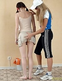 Coach puts leather collar on naked trainee