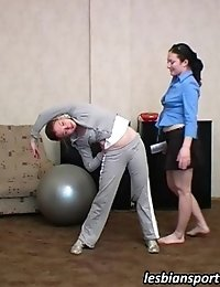Flexy girl gets coached and caressed by a lezzy