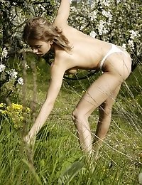 Romantic Teen Girl Bends Down To Get Flowers For Her Diadem Showing Her Butt In Panties