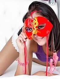 Wonderful Slim Dark Haired Girl With Two Masquerade Masks Undressing And Spreading Legs.