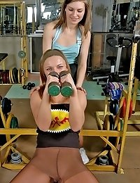 Two angels in pantyhose exercising in gym