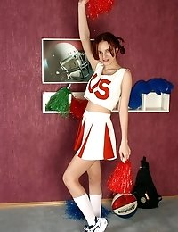 Lovely cheerleader strips off and plays with herself
