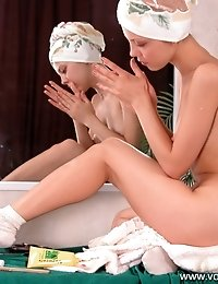 Juicy young doll putting makeup on naked