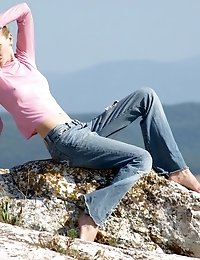 Charming Teen Babe Stripping Totally Nude And Sexually Posing On A Rocky Mountain Plateau.