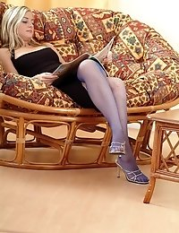 Blonde busty Monique in sexy fishnets