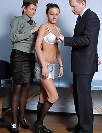 Two customs examiners giving a hard medical time