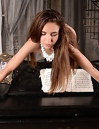 Flawless Teen Babe Showing Off Her Amazing Curves On A Piano With An Artistic Form That Expresses De