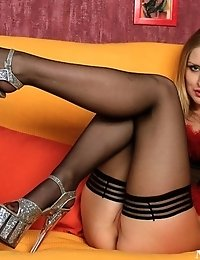 Gorgeous Bella in stockings and high heels