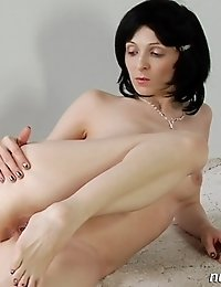Slender babe practices naked stretching