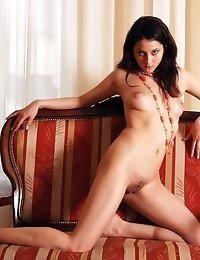20 Photos Of Naked Brunette Lying On The Couch And Opening Her Cute Long Legs Wide