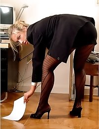 Blonde secretary Emilly in fashion pantyhose posing on office desk