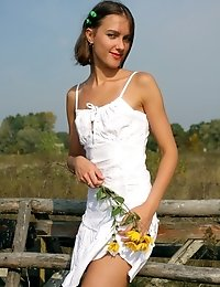 Attractive Gal Plays With Her Neat White Dress While Posing Outdoors.