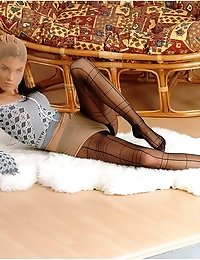 Flexible brunette Jackie spreading her legs in pantyhose lying on floor