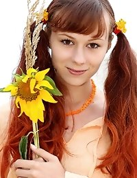 Cheerful Teen Girl Poses With A Sunflower Then Strips Down Totally Naked.
