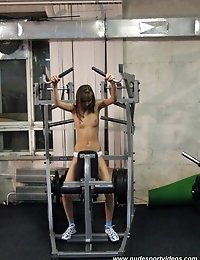 Sexy nude sportsbabe at gym apparatus