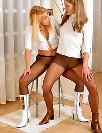 A pair of horny lesbians in pantyhose and boots