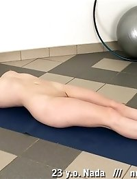 Fit redhead undresses for nude exercising