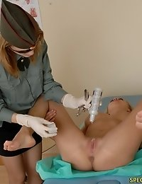 Army doctor inspects a vag with a speculum