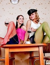 Hely and Cindy play with red and green pantyhose