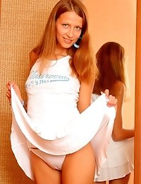 Fascinating Blue-eyed Teen Undresses Just In Her Room Near Brown Wardrobe And Is Burning From Desire