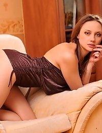 Alluring Teen Girl Sexually Posing On A Couch And Showing Off Her Naturally Hairy Twat.