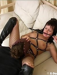 Gorgeous Dominatrix in fishnets and her ponyboy!
