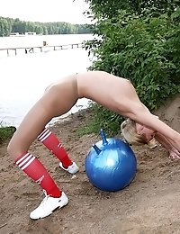 Intense riverside fitball gymnastics in pantyhose
