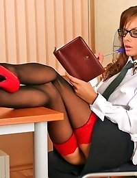 Young office babe wearing stockings & sexy red pumps