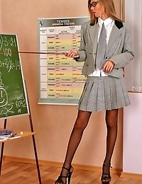Dream young teacher dressed in stockings & heels!