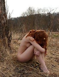 Thrilling Captivating Angel Is Walking Alone In The Deserted Autumn Field And Gaily Dances Near The