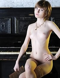 Gorgeous Naked Teen Beauty In Lace Stockings Revels In Her Erotic Dreams By The Old Piano.