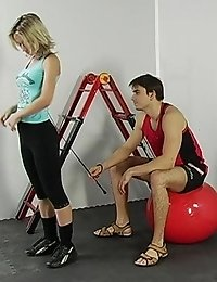 Blond trained in fitball sports by a male coacher