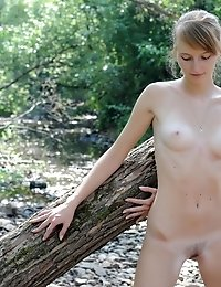 Lovely Teen Girl Dares To Strip And Pose Naked For The First Time In Front Of The Camera.