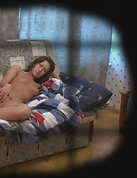 Nude college girl masturbating on the couch