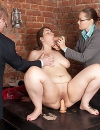 Chubby secretary interviewed with dildos on the table