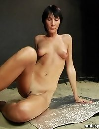Studio naked gymnastics by a tall brune