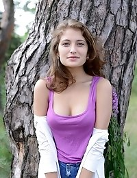 Cute Brunette Babe Plays Around In The Woods, Embracing Her Sexy Body And Her Childish Spirit.